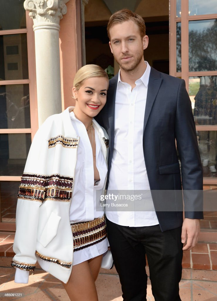 Singer/songwriter Rita Ora (L) and DJ/Producer Calvin Harris attend the Roc Nation Pre-GRAMMY Brunch Presented by MAC Viva Glam at Private Residence on January 25, 2014 in Beverly Hills, California.