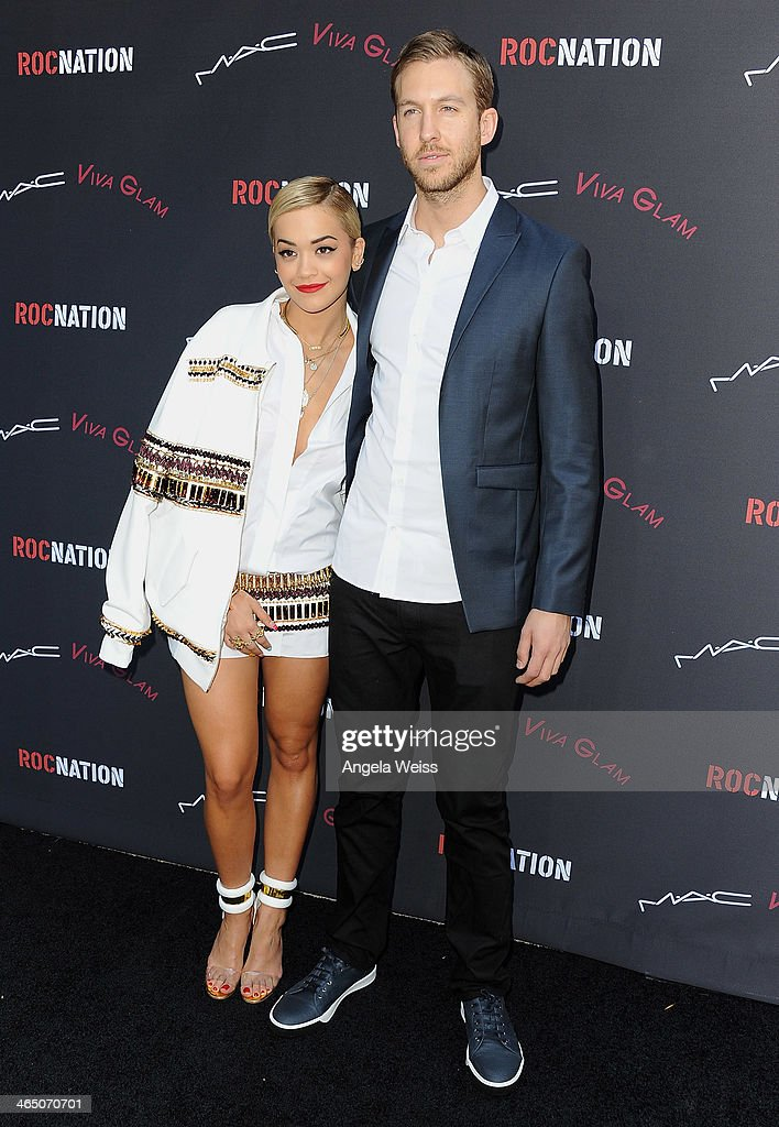Singer/songwriter <a gi-track='captionPersonalityLinkClicked' href=/galleries/search?phrase=Rita+Ora&family=editorial&specificpeople=5686485 ng-click='$event.stopPropagation()'>Rita Ora</a> and record producer <a gi-track='captionPersonalityLinkClicked' href=/galleries/search?phrase=Calvin+Harris&family=editorial&specificpeople=4412722 ng-click='$event.stopPropagation()'>Calvin Harris</a> arrive at the Roc Nation Pre-Grammy brunch presented by MAC Viva Glam at a private residency on January 25, 2014 in Los Angeles, California.