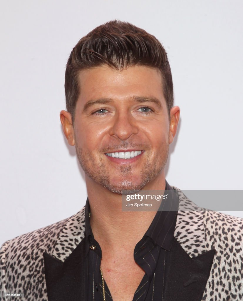 Singer/songwriter <a gi-track='captionPersonalityLinkClicked' href=/galleries/search?phrase=Robin+Thicke&family=editorial&specificpeople=724390 ng-click='$event.stopPropagation()'>Robin Thicke</a> attends Z100's Jingle Ball 2013 at Madison Square Garden on December 13, 2013 in New York City.
