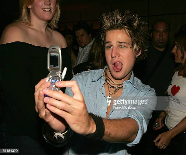 Singer/songwriter Ryan Cabrera takes a self portrait with a Samsung picture phone at the album release party for his Atlantic Records release 'Take...