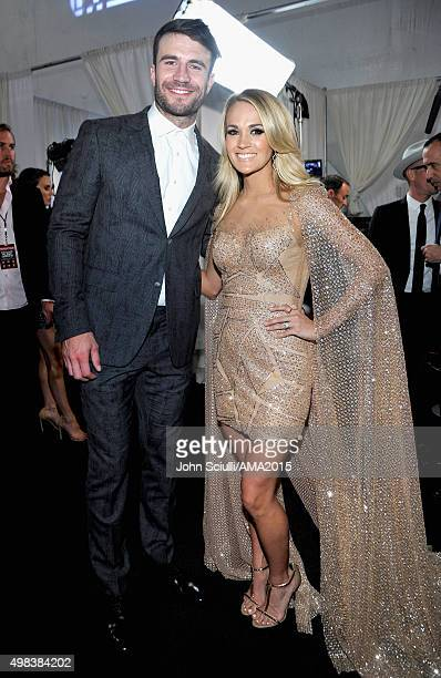 Singersongwriter Sam Hunt and recording artist Carrie Underwood attends the 2015 American Music Awards at Microsoft Theater on November 22 2015 in...