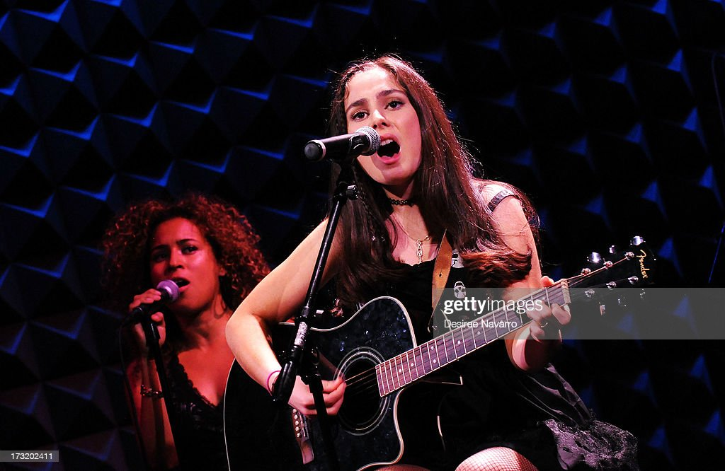 Singer/songwriter Samia Najimy Finnerty performs at Samia Najimy Finnerty PETA Ad Unveiling & Performance at Joe's Pub on July 9, 2013 in New York City.