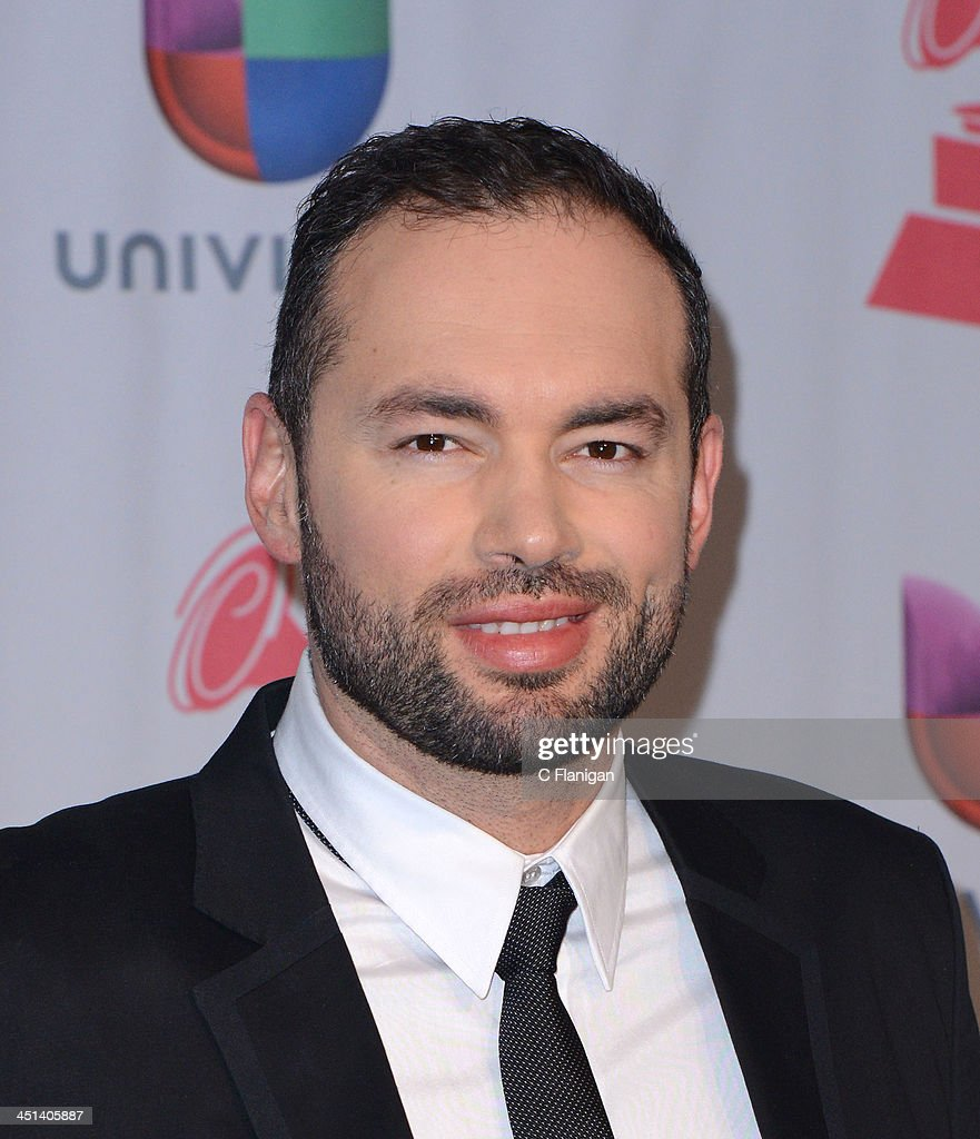 Singer/songwriter Santiago Cruz poses backstage during the 14th Annual Latin GRAMMY Awards at Mandalay Bay Events Center on November 21, 2013 in Las Vegas, Nevada.