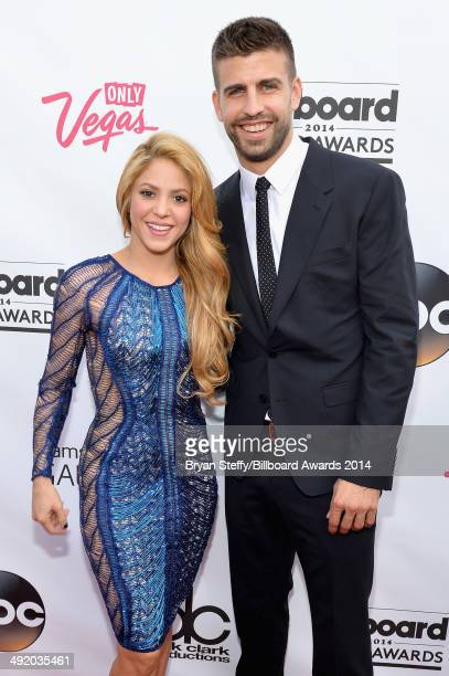 Singersongwriter Shakira and professional soccer player Gerard Pique attend the 2014 Billboard Music Awards at the MGM Grand Garden Arena on May 18...