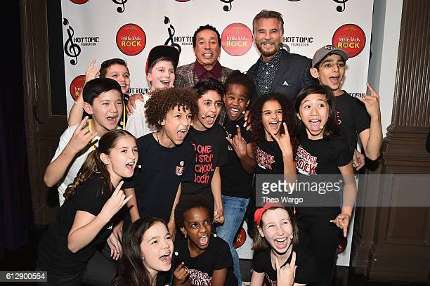 Singersongwriter Smokey Robinson and singer Kenny Loggins pose backstage with kids from School of Rock during Little Kids Rock Benefit 2016 at...