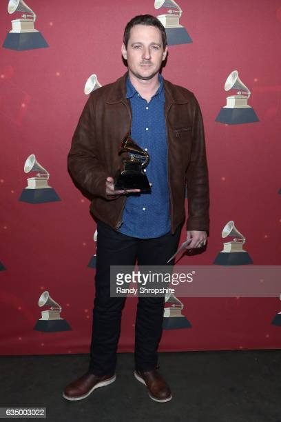 Singer/songwriter Sturgill Simpson poses with the Best Country Album award for 'A Sailor's Guide to Earth' backstage at the Premiere Ceremony during...