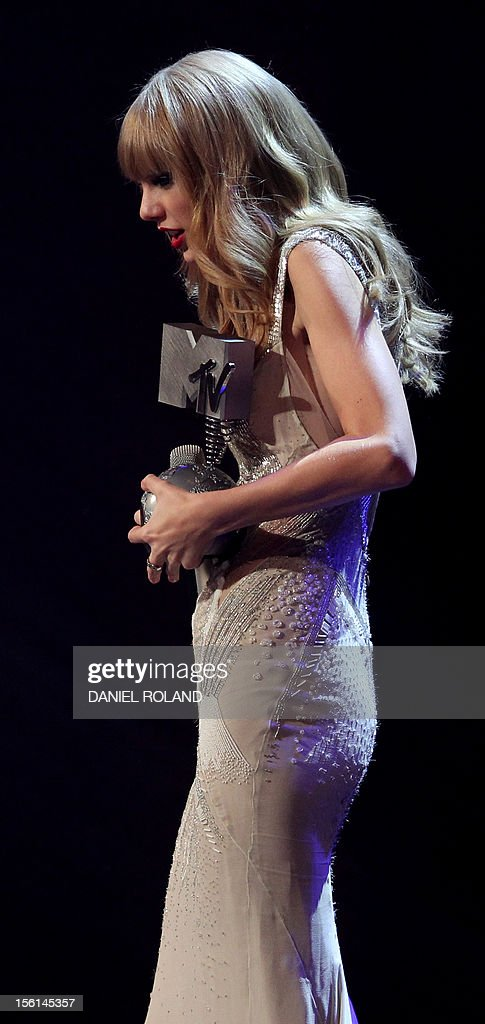 US singer-songwriter Taylor Swift after receiving one of her three awards during the 2012 MTV European Music Awards (EMA) at the Festhalle in Frankfurt am Main, central Germany on November 11, 2012.