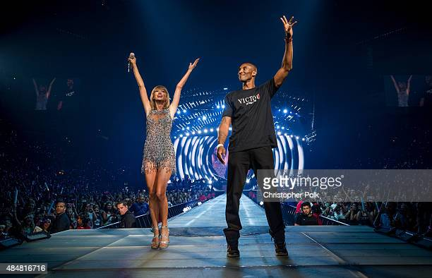 Singersongwriter Taylor Swift and NBA player Kobe Bryant speak onstage during The 1989 World Tour Live In Los Angeles at Staples Center on August 21...