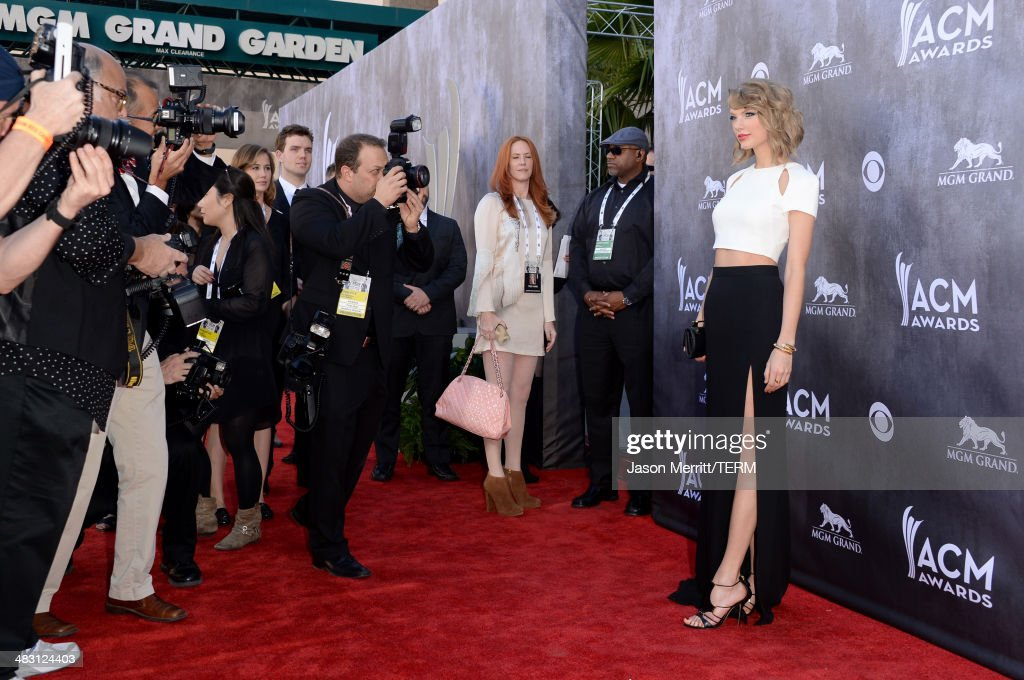 Singer/songwriter <a gi-track='captionPersonalityLinkClicked' href=/galleries/search?phrase=Taylor+Swift&family=editorial&specificpeople=619504 ng-click='$event.stopPropagation()'>Taylor Swift</a> attends the 49th Annual Academy Of Country Music Awards at the MGM Grand Garden Arena on April 6, 2014 in Las Vegas, Nevada.