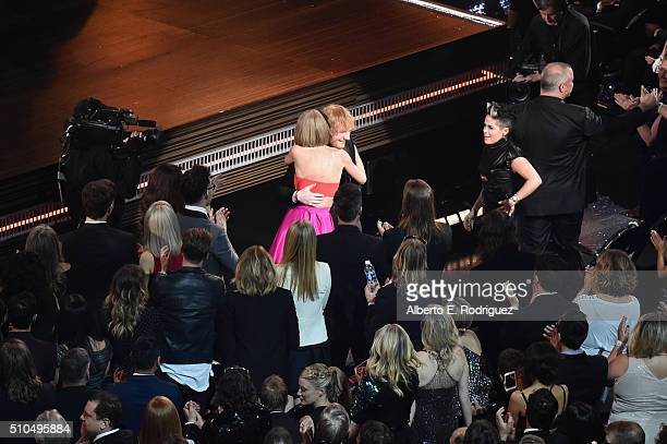 Singersongwriter Taylor Swift hugs singersongwriter Ed Sheeran during The 58th GRAMMY Awards at Staples Center on February 15 2016 in Los Angeles...