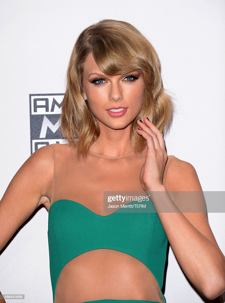 Singer/songwriter Taylor Swift poses in the press room at the 2014 American Music Awards at Nokia Theatre L.A. Live on November 23, 2014 in Los Angeles, California.
