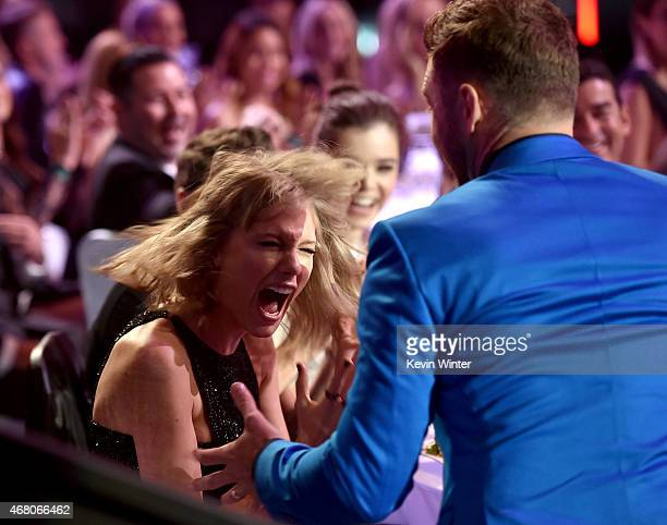 Singer/songwriter Taylor Swift reacts to winning the Best Lyrics award for 'Blank Space' with singer Justin Timberlake in the audience during the...