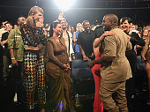 Singersongwriter Taylor Swift TV personalities Kim Kardashian Kourtney Kardashian rapper Kanye West and TV personality Kris Jenner in the audience...