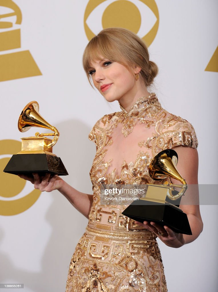 Singer/songwriter Taylor Swift, winner of the GRAMMYs Best Country Song with 'Mean' and Best Country Solo Performance for 'Mean', poses in the press room at the 54th Annual GRAMMY Awards at Staples Center on February 12, 2012 in Los Angeles, California.