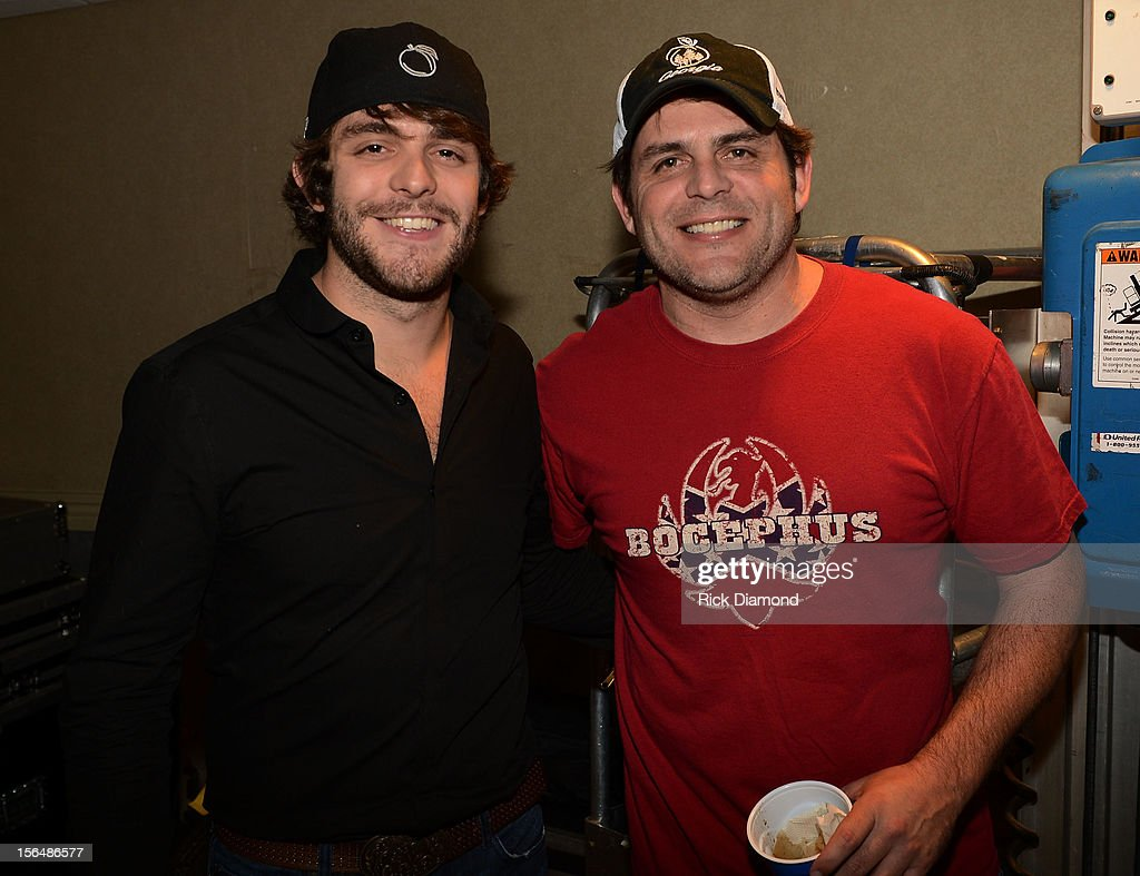 Singer/Songwriter Thomas Rhett and his dad Singer/Songwriter Rhett Akins backstage during Opening Night of Chris Young's Liquid Neon Tour (SOLD OUT) at the Ryman Auditorium on November 15, 2012 in Nashville, Tennessee.