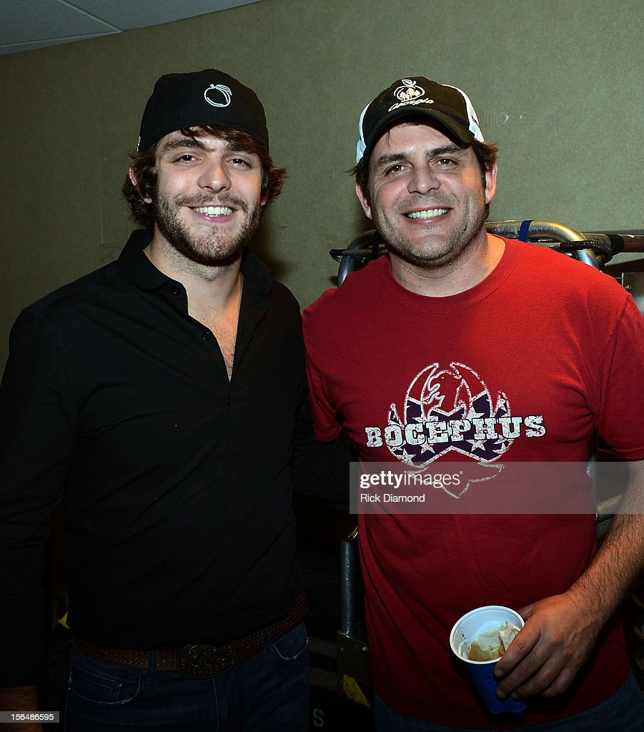 Singer/Songwriter <a gi-track='captionPersonalityLinkClicked' href=/galleries/search?phrase=Thomas+Rhett&family=editorial&specificpeople=9092574 ng-click='$event.stopPropagation()'>Thomas Rhett</a> and his dad Singer/Songwriter Rhett Akins backstage during Opening Night of Chris Young's Liquid Neon Tour (SOLD OUT) at the Ryman Auditorium on November 15, 2012 in Nashville, Tennessee.