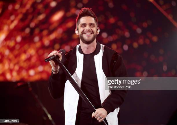 Singersongwriter Thomas Rhett performs onstage at the 2017 iHeartRadio Music Awards which broadcast live on Turner's TBS TNT and truTV at The Forum...