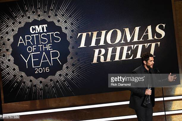 Singersongwriter Thomas Rhett recieves an award on stage during CMT Artists of the Year 2016 on October 19 2016 in Nashville Tennessee
