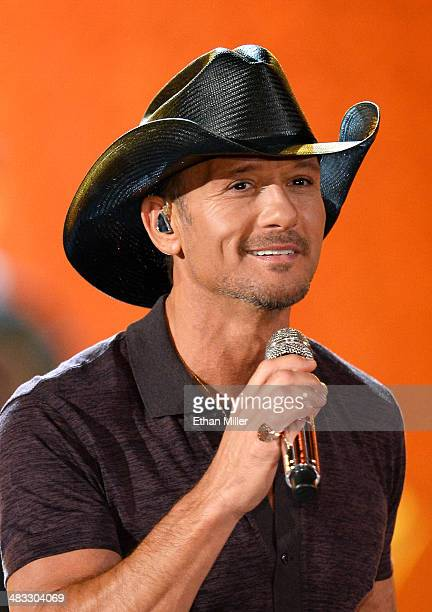Singer/songwriter Tim McGraw performs onstage during ACM Presents An AllStar Salute To The Troops at the MGM Grand Garden Arena on April 7 2014 in...