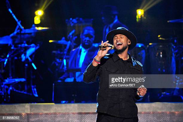 Singersongwriter Usher performs on stage during the BET Honors 2016 Show at Warner Theatre on March 5 2016 in Washington DC