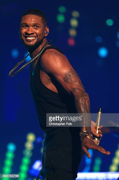 Singer/songwriter Usher performs onstage during the 2014 iHeartRadio Music Festival at the MGM Grand Garden Arena on September 19 2014 in Las Vegas...