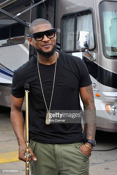 Singersongwriter Usher poses backstage during Global Citizen 2015 Earth Day on National Mall to end extreme poverty and solve climate change on April...