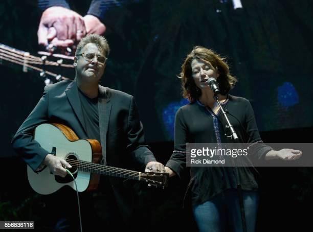 Singer/Songwriter Vince Gill joins Singer/Songwriter Amy Grant in prayer during Nashville Candelight Vigil For Las Vegas at Ascend Amphitheater on...