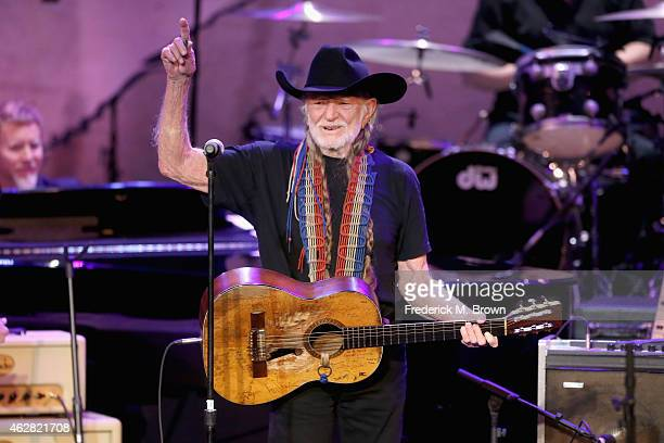 Singersongwriter Willie Nelson performs onstage during the GRAMMY Foundation's 17th annual Legacy Concert Lean On Me A Celebration of Music and...
