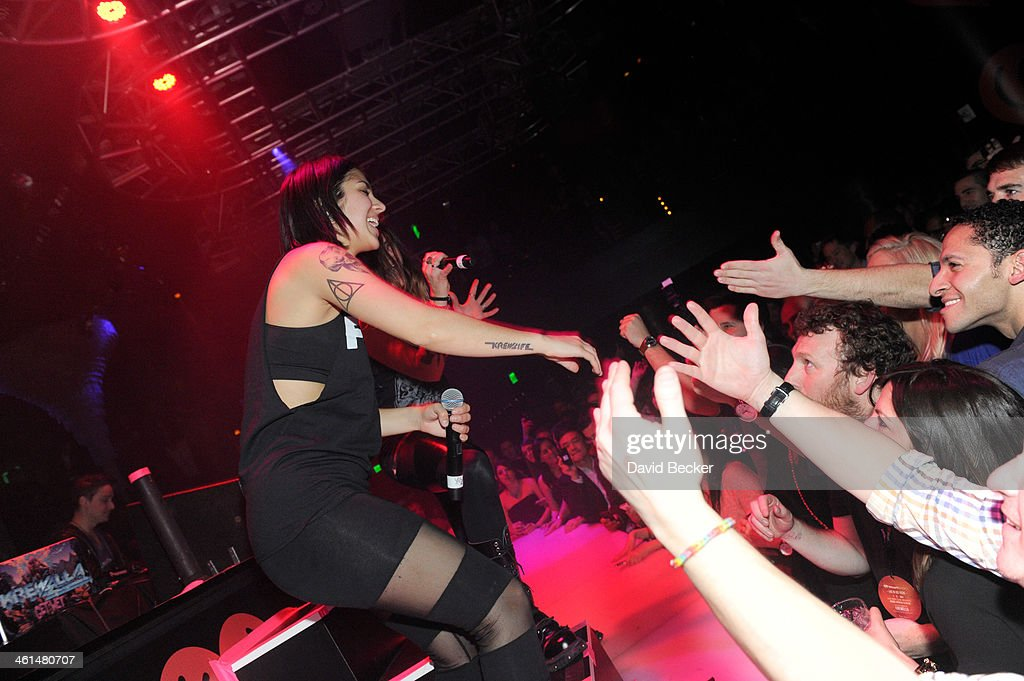 Singer/songwriter Yasmine Yousaf of Krewella performs onstage at a private party celebrating CES 2014 hosted by iHeartRadio featuring a live performance by Krewella at Haze Nightclub at the Aria Resort & Casino at CityCenter on January 8, 2014 in Las Vegas, Nevada.