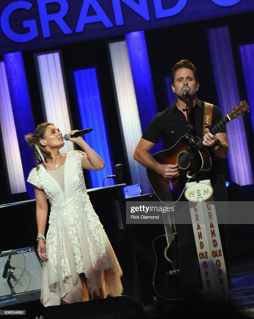 Singer/Songwriter/Actor Clare Bowen joins Singer/Songwriter/Actor Charles Esten on stage during Grand Ole Opry Total Eclipse 2017 Special Sunday Night Show at Grand Ole Opry House on August 20, 2017 in Nashville, Tennessee.