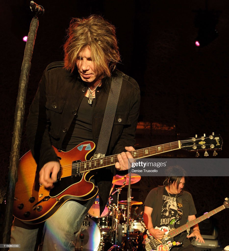 Singer/songwriter/guitarist John Rzeznik and singer/songwriter/bass guitarist Robby Takac of the Goo Goo Dolls performs at the Couture Las Vegas...