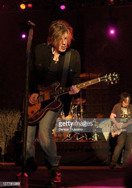 Singer/songwriter/guitarist John Rzeznik drummer Mike Malinin and singer/songwriter/bass guitarist Robby Takac of the Goo Goo Dolls performs at the...