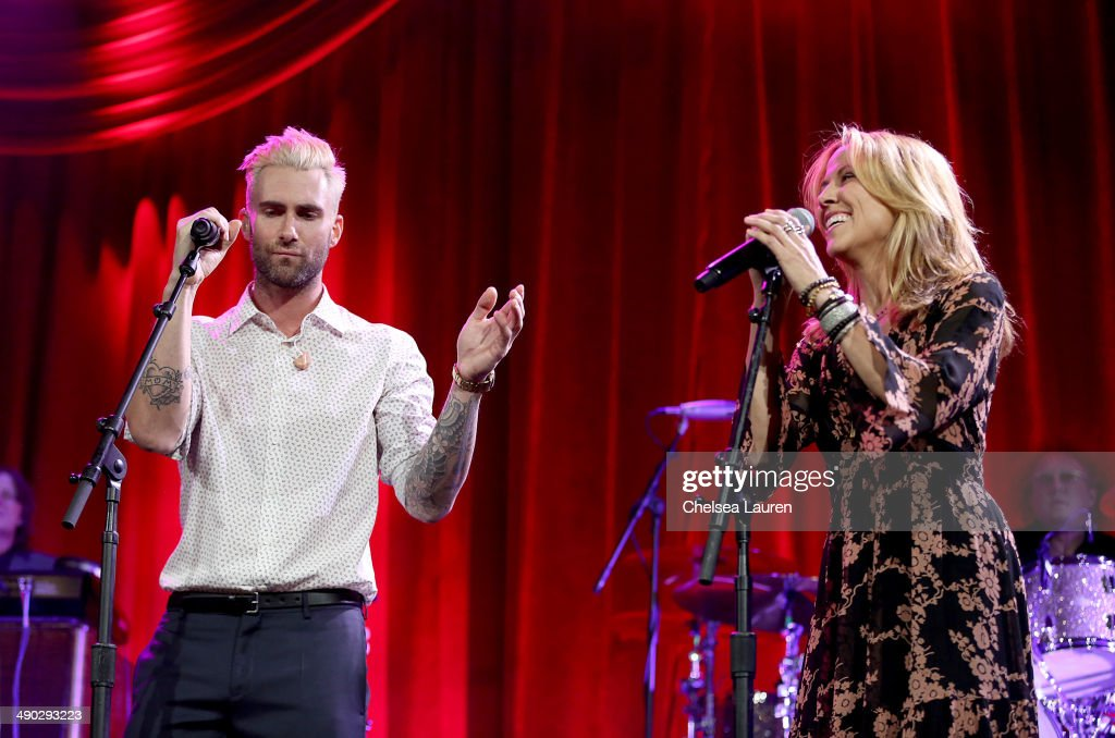 Singer-songwriters <a gi-track='captionPersonalityLinkClicked' href=/galleries/search?phrase=Adam+Levine+-+Singer&family=editorial&specificpeople=202962 ng-click='$event.stopPropagation()'>Adam Levine</a> (L) and <a gi-track='captionPersonalityLinkClicked' href=/galleries/search?phrase=Sheryl+Crow&family=editorial&specificpeople=201867 ng-click='$event.stopPropagation()'>Sheryl Crow</a> perform at the 2014 BMI Pop Awards at the Beverly Wilshire Four Seasons Hotel on May 13, 2014 in Beverly Hills, California.