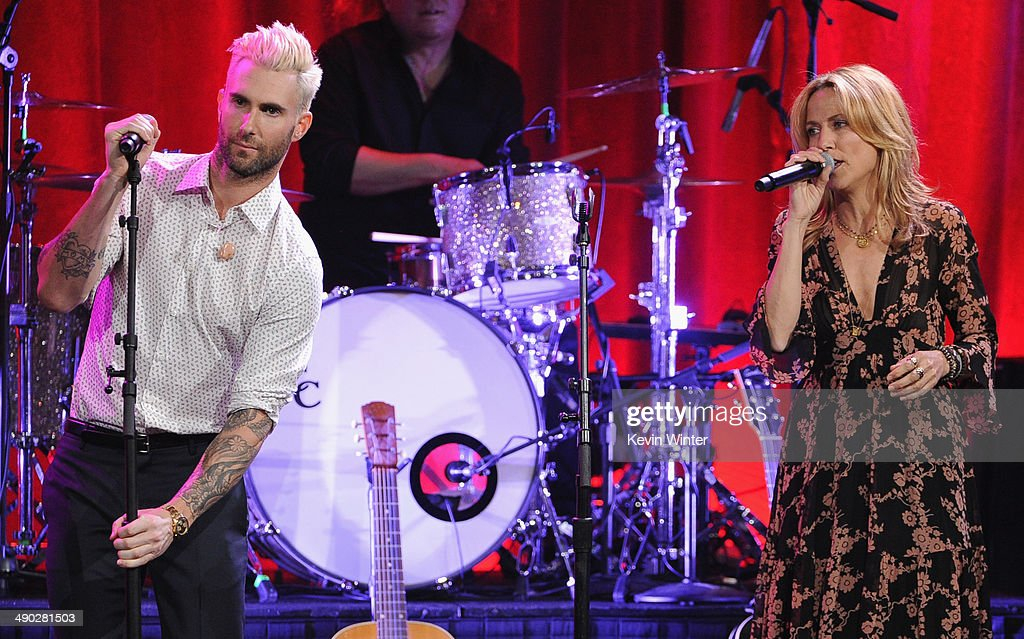 Singer-songwriters Adam Levine of Maroon 5 (L) and Sheryl Crow perform onstage at the 62nd annual BMI Pop Awards at the Regent Beverly Wilshire Hotel on May 13, 2014 in Beverly Hills, California.