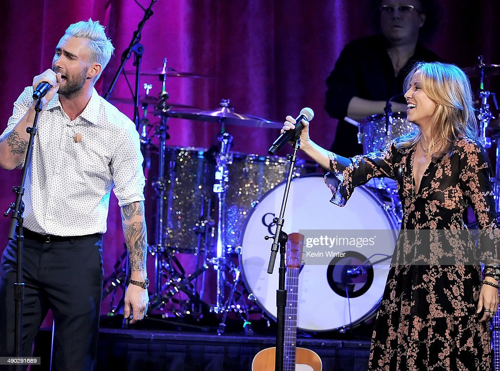 Singer-songwriters <a gi-track='captionPersonalityLinkClicked' href=/galleries/search?phrase=Adam+Levine+-+Singer&family=editorial&specificpeople=202962 ng-click='$event.stopPropagation()'>Adam Levine</a> of Maroon 5 (L) and <a gi-track='captionPersonalityLinkClicked' href=/galleries/search?phrase=Sheryl+Crow&family=editorial&specificpeople=201867 ng-click='$event.stopPropagation()'>Sheryl Crow</a> perform onstage at the 62nd annual BMI Pop Awards at the Regent Beverly Wilshire Hotel on May 13, 2014 in Beverly Hills, California.