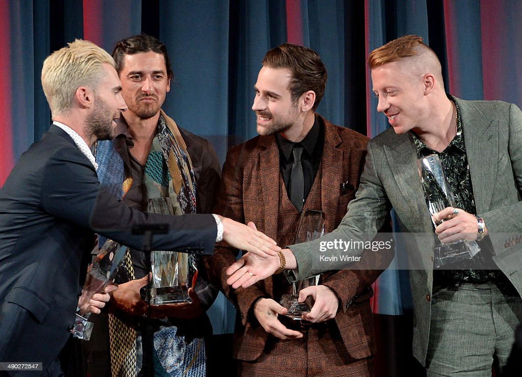 Singer-songwriters Adam Levine of Maroon 5, Jeff Bhasker, Ryan Lewis and Macklemore accept the 2014 BMI Songwriter of the Year Awards onstage at the 62nd annual BMI Pop Awards at the Regent Beverly Wilshire Hotel on May 13, 2014 in Beverly Hills, California.