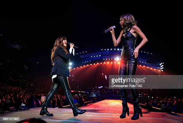 Singersongwriters Alanis Morissette and Taylor Swift perform onstage during Taylor Swift The 1989 World Tour Live In Los Angeles at Staples Center on...