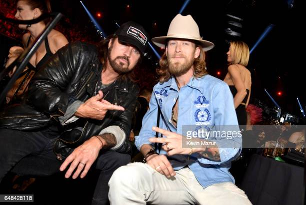 Singersongwriters Billy Ray Cyrus and Brian Kelley of Florida Georgia Line attend the 2017 iHeartRadio Music Awards which broadcast live on Turner's...