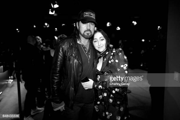 Singersongwriters Billy Ray Cyrus and Noah Cyrus pose backstage at the 2017 iHeartRadio Music Awards which broadcast live on Turner's TBS TNT and...