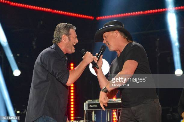 Singer/songwriters Blake Shelton and Trace Adkins perform at Nissan Stadium during day 2 of the 2017 CMA Music Festival on June 9 2017 in Nashville...