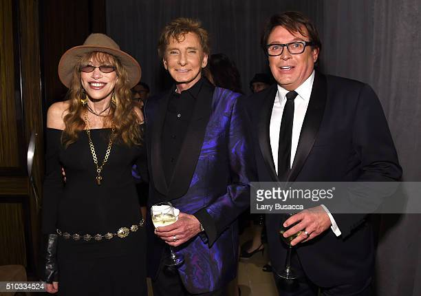 Singersongwriters Carly Simon and Barry Manilow and Garry Kief attend the 2016 PreGRAMMY Gala and Salute to Industry Icons honoring Irving Azoff at...