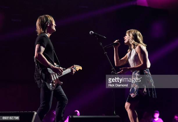 Singersongwriters Carrie Underwood and Keith Urban perform onstage during the 2017 CMT Music Awards rehearsals at Music City Convention Center on...