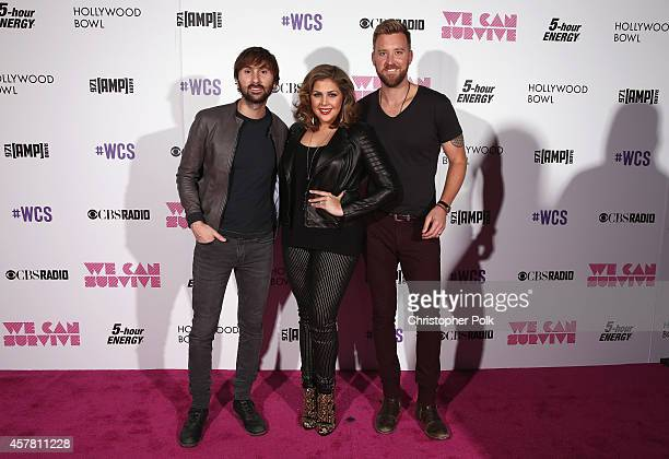 Singer/songwriters Dave Haywood Hillary Scott and Charles Kelley pose backstage during CBS Radio's We Can Survive at the Hollywood Bowl on October 24...
