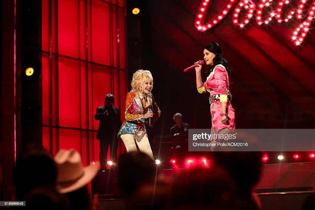 Singer-songwriters Dolly Parton (L) and Katy Perry perform onstage at the 51st Academy of Country Music Awards at MGM Grand Garden Arena on April 3, 2016 in Las Vegas, Nevada.