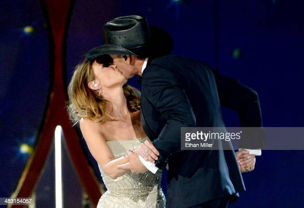Singer/songwriters Faith Hill and Tim McGraw perform onstage during the 49th Annual Academy of Country Music Awards at the MGM Grand Garden Arena on...