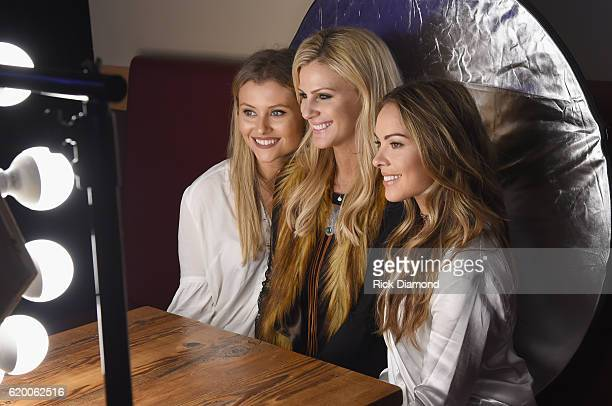 Singersongwriters Hannah Mulholland Jennifer Wayne and Naomi Cooke of Runaway June take photos together before CMT's Next Women of Country on...