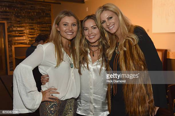 Singersongwriters Hannah Mulholland Naomi Cooke and Jennifer Wayne of Runaway June take photos together before CMT's Next Women of Country on...