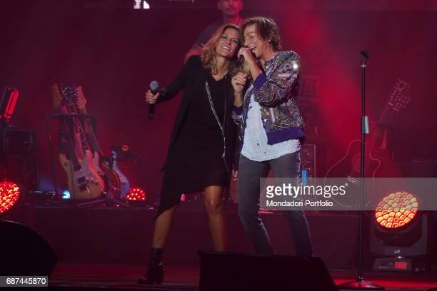 Singersongwriters Irene Grandi and Gianna Nannini performing during Amiche in Arena a concert against femicide and violence against women conceived...
