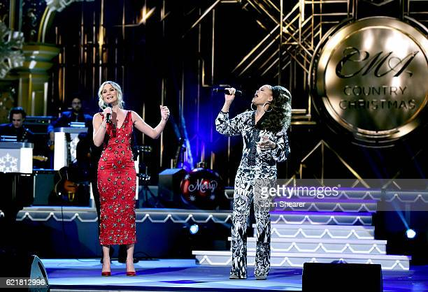 Singersongwriters Jennifer Nettles and Andra Day perform on stage during the CMA 2016 Country Christmas on November 8 2016 in Nashville Tennessee