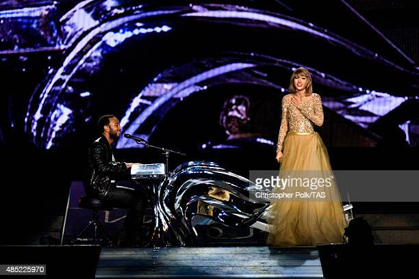 Singersongwriters John Legend and Taylor Swift perform onstage during Taylor Swift The 1989 World Tour Live In Los Angeles at Staples Center on...